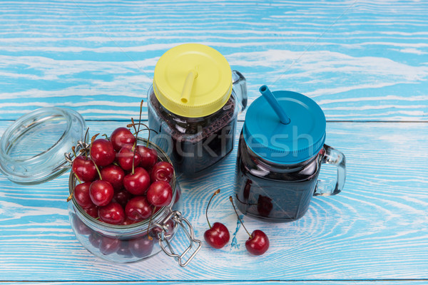 Kiraz meyve suyu cam karpuzu kavanoz mavi Stok fotoğraf © olira