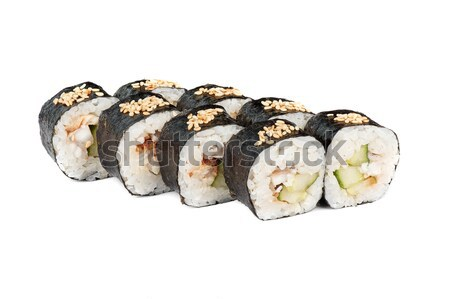 Roll made cucumber, smoked eel and sesame Stock photo © olira