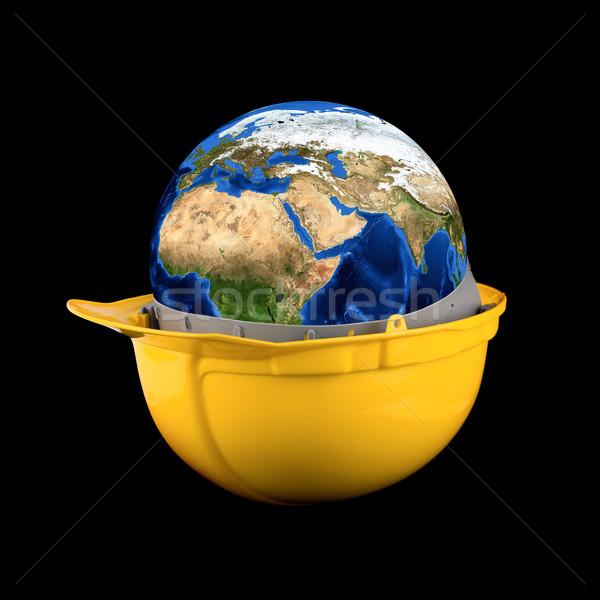 Amarillo casco tierra planeta negro fondo Foto stock © olira