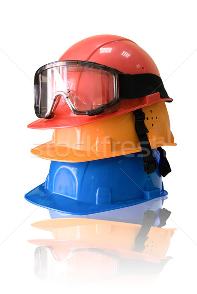 Many colored hardhats and goggles Stock photo © olira