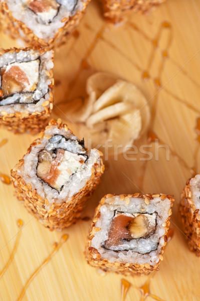 sesame sushi rolls Stock photo © olira