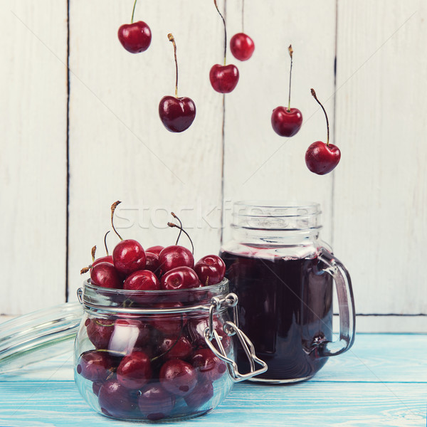 Cherry juice with glass of berries Stock photo © olira