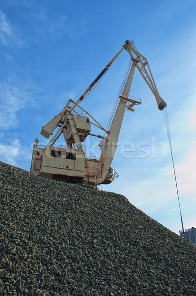 crane at heap of gravel Stock photo © olira
