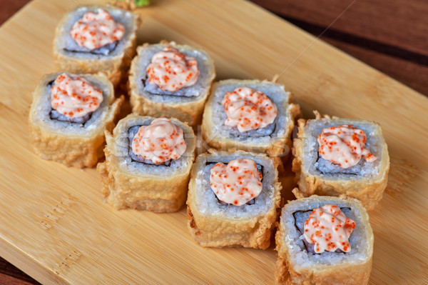 Stock photo: cream cheese and tobico sushi roll