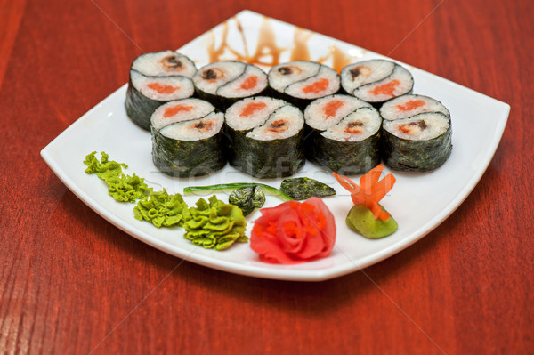 Stock photo: Roll with smoked eel and salmon