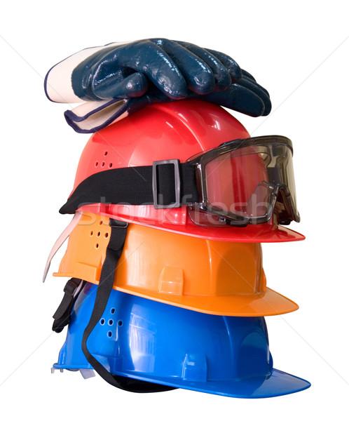 Many colored hardhats, gloves and goggles Stock photo © olira