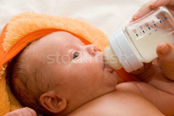 Stock photo: feeding baby