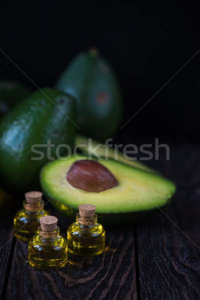 Olie avocado donkere houten medische vruchten Stockfoto © olira
