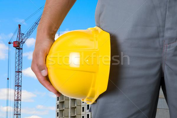 Construtor amarelo capacete mãos edifício Foto stock © olira