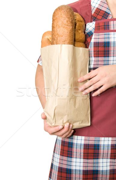 хлеб продавец равномерный девушки долго буханка Сток-фото © olira