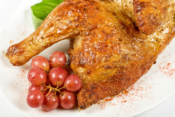 Half roasted chicken closeup Stock photo © olira