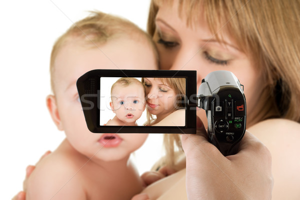 mother with her baby boy at camcorder Stock photo © olira