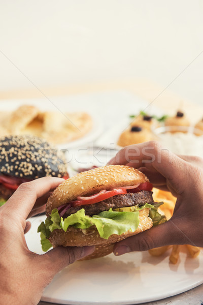 Man eating burgers Stock photo © olira