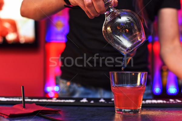 Barmen making cocktail Stock photo © olira