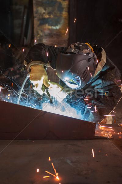 worker welding metal Stock photo © olira