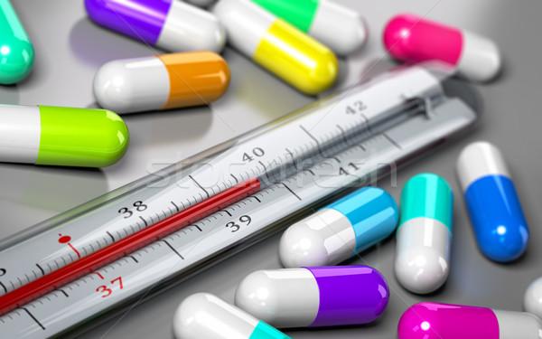 Antibiótico termómetro muchos pastillas alrededor gris Foto stock © olivier_le_moal