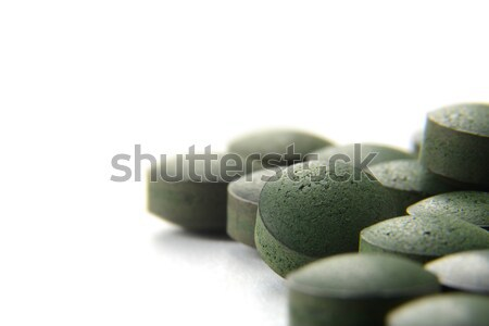 Pure Organic Spirulina Tablets Over White Background, Dietary Su Stock photo © olivier_le_moal