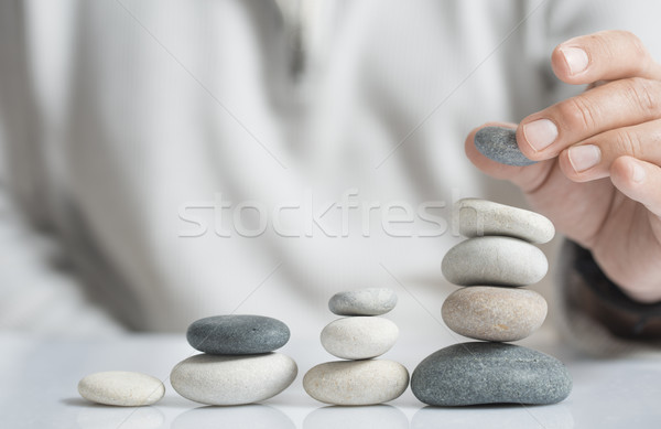 Asset Management horizontal Bild Mann Kieselsteine Stock foto © olivier_le_moal