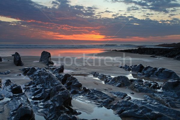 Pôr do sol norte costa praia sul ocidente Foto stock © ollietaylorphotograp