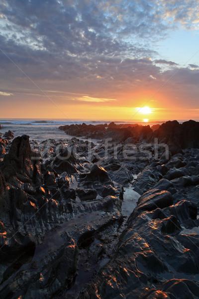 Gün batımı kuzey sahil plaj güney batı Stok fotoğraf © ollietaylorphotograp
