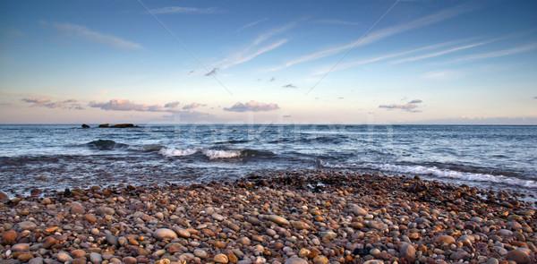 Plaj gün batımı canlı gökyüzü su manzara Stok fotoğraf © ollietaylorphotograp