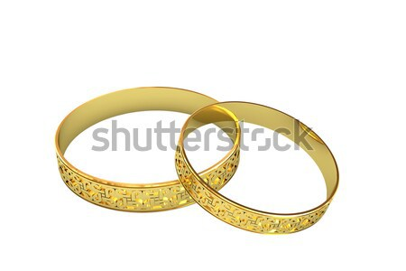 Stock photo: Golden wedding rings with magic tracery