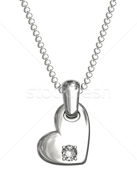 Platinum or silver pendant in shape of heart with diamond Stock photo © oneo