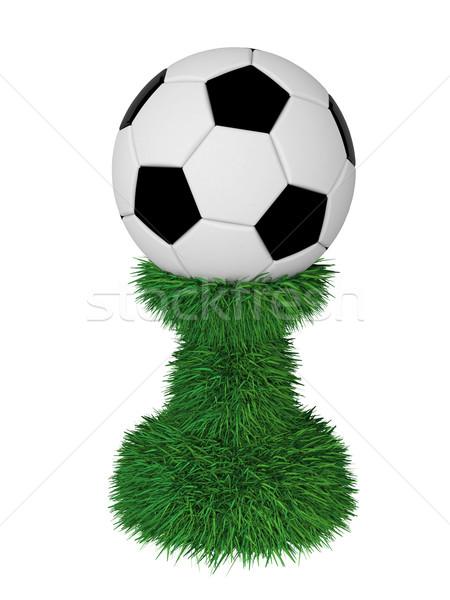 Soccer ball trophy on green grass pedestal Stock photo © oneo