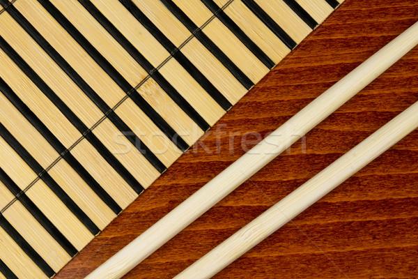 Pałeczki do jedzenia bambusa tle tabeli japoński owoce morza Zdjęcia stock © oorka