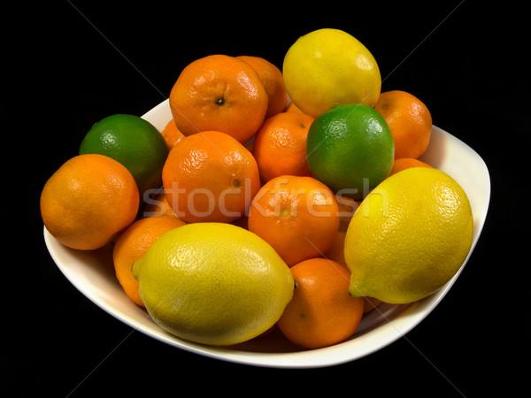 Citrus gyümölcsök csésze izolált fekete étel Stock fotó © oorka