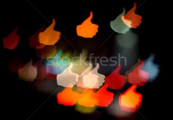 Bokeh fények hüvelykujj felfelé fekete terv Stock fotó © oorka