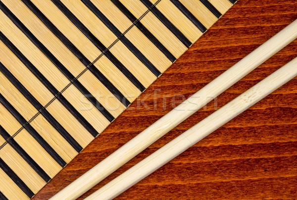Chopsticks and bamboo mat Stock photo © oorka