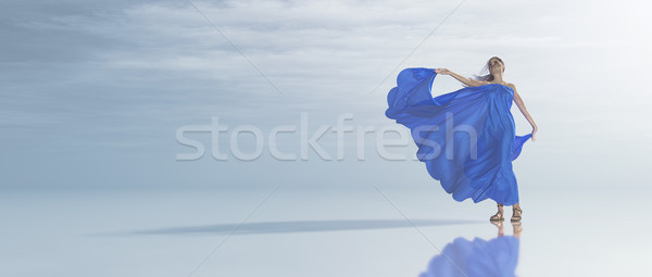 Young woman in blue dress on the seashore tropical Stock photo © orla