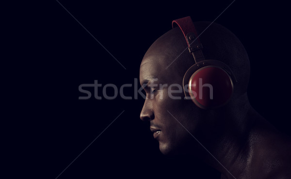 Young man listening to music  Stock photo © orla