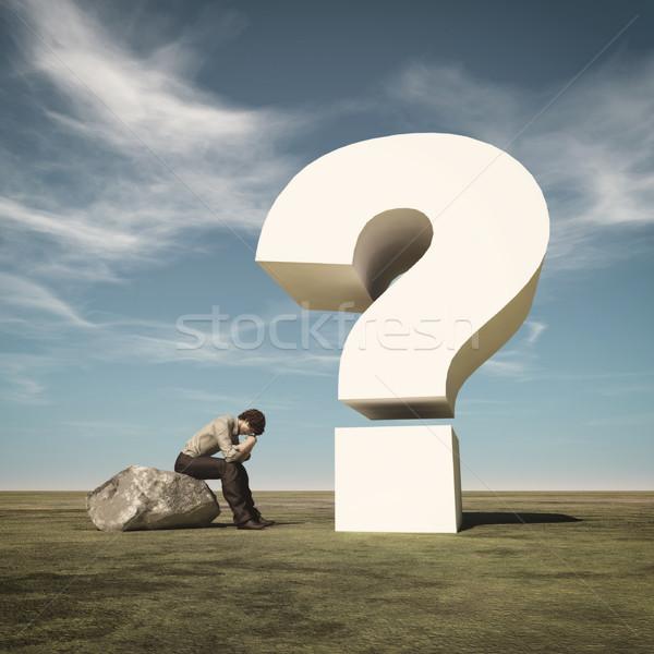 Fiatalember ül kő gondolkodik nagy kérdőjel Stock fotó © orla