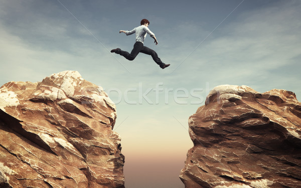 Young man jumping Stock photo © orla