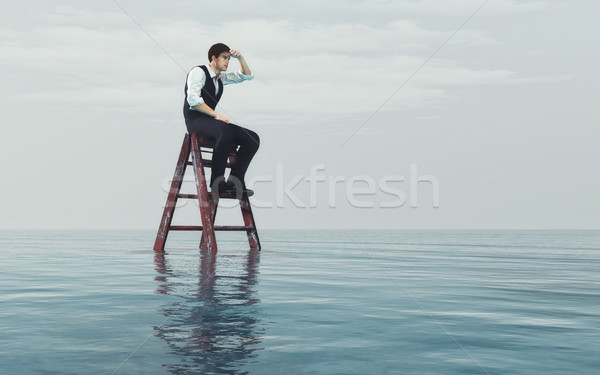 Young  man sits on a ladder  Stock photo © orla