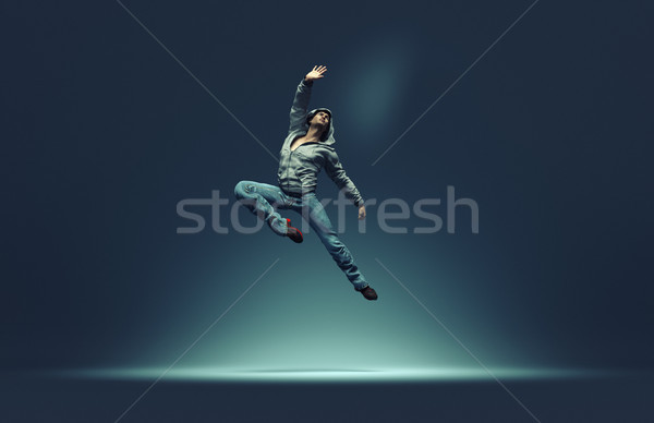 Jumping man strikes pose Stock photo © orla