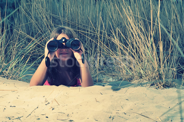 Young girl looking through binocular, low angle view  Stock photo © orla