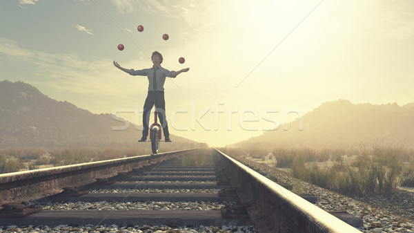 Juggler is balancing on railroad Stock photo © orla