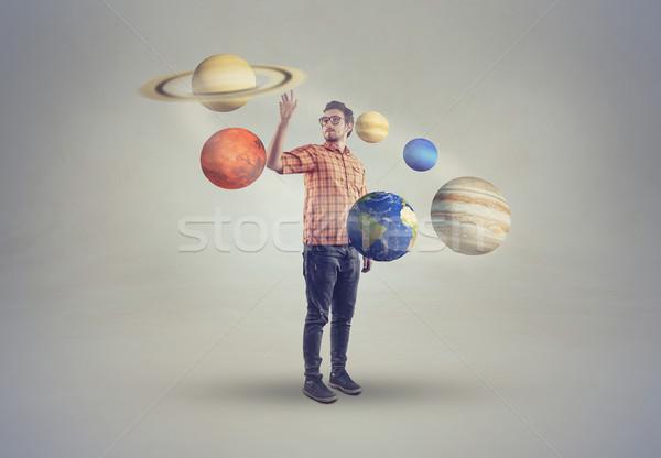 Moço meio sistema solar indicação homem lua Foto stock © orla
