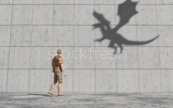 Man looks at the shadow of a dragon on the wall.  Stock photo © orla
