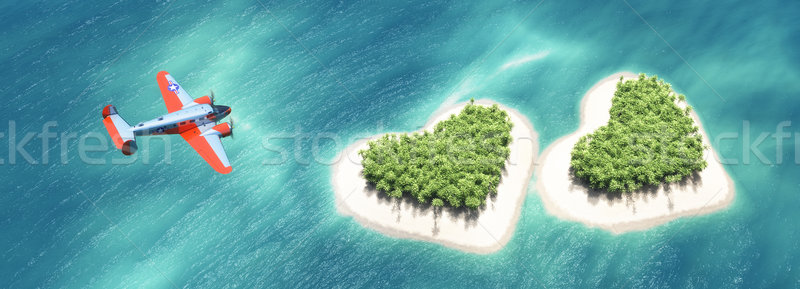 Airplane above the second heart-shaped tropical island  Stock photo © orla