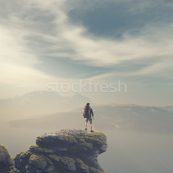 Hiker with backpack standing on top of a mountain Stock photo © orla