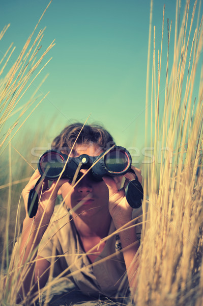 Young boy looking through binocular, low angle view  Stock photo © orla