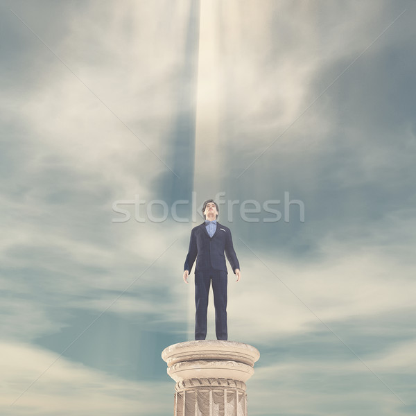 Businessman standing on a column  Stock photo © orla
