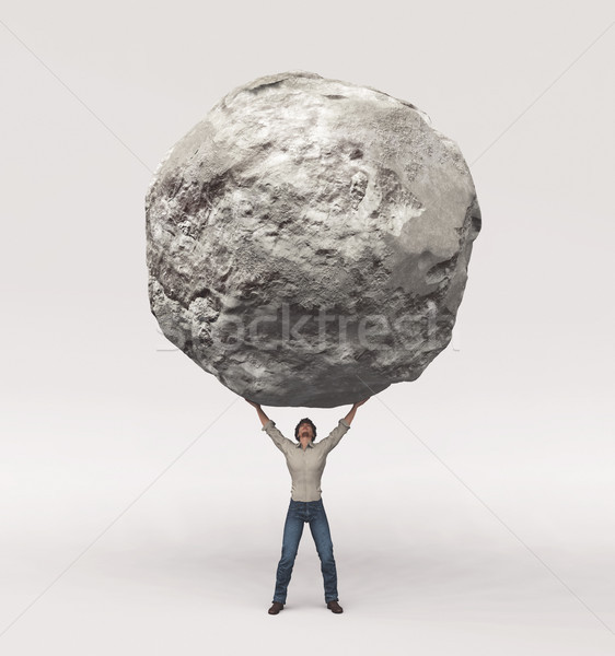 Young man pick up a large rock  Stock photo © orla