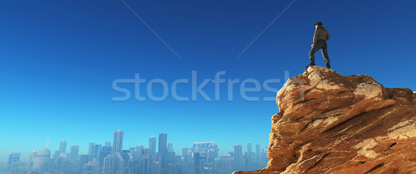 Young man at the top of the stone  Stock photo © orla