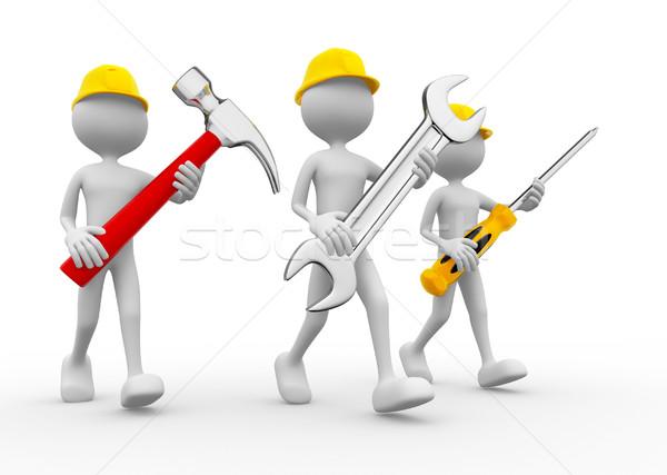 Trzy osoby narzędzia ręce strony pracy projektu Zdjęcia stock © orla