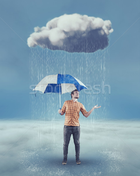 Young man holding an umbrella  Stock photo © orla